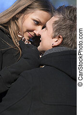 portrait of young caucasian couple enjoying each other in the  park area