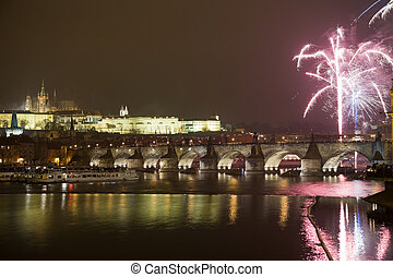 New Year 2009 celebration with fireworks in Prague above...