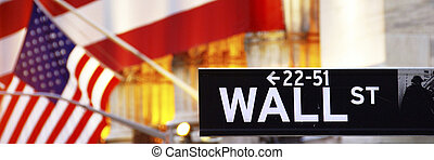 Wall Street, street sign, with US flag, in New York City