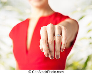 woman showing wedding ring on her hand - picture of woman...