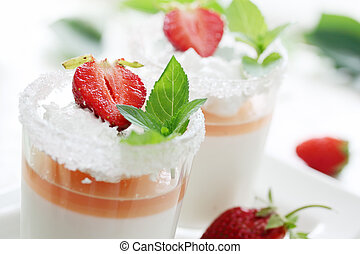 dessert with cream - cream jelly with strawberries in a...