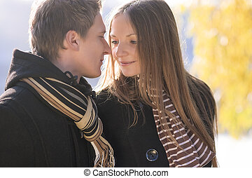 young couple having a walk in the park
