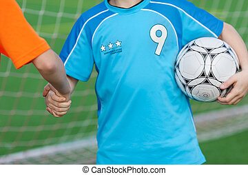 young soccer players shaking hands