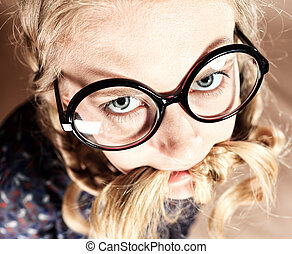 braid in mouth - Portrait of a funny blonde girl in big...