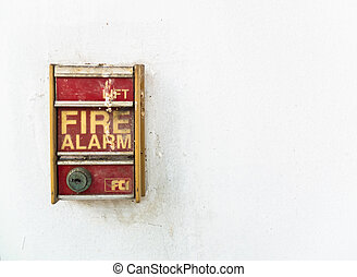 Old fire Alarm - A close-up photo of a bright red fire alarm...
