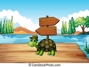 A turtle at the wooden bridge with an empty signboard -...