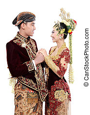 Traditional java wedding couple husband and wife hold each other isolated over white background