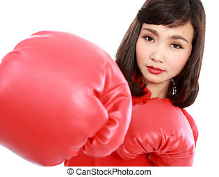 Young woman wearing boxing gloves isolated on white...