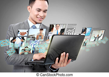 business man with laptop - Portrait of businessman using...