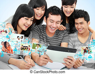 Friendly group of students with tablet pc - Group of...