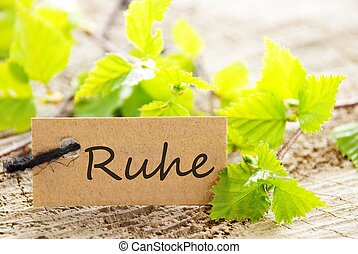 label with Ruhe - a natural looking label with green leaves...