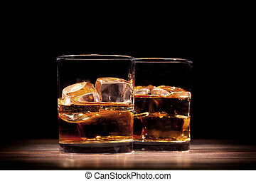 Whiskey - Couple of whiskey drinks on wooden table