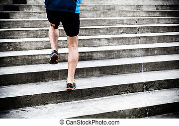 Man running on stairs, sports training - Man runner running...