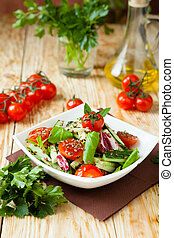 salad with cucumbers and tomatoes, close up