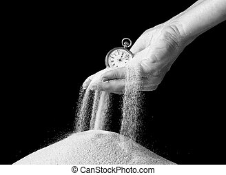 Hand holding sand and clock - Female hand holding an antique...