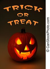 Trick or treat pumpkin - Scary face cut into pumpkin for...