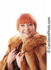 Pretty woman in fur coat over light background