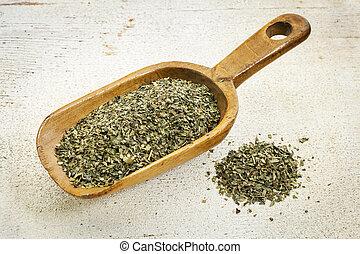 scoop of peppermint tea - organic peppermint herbal tea -...