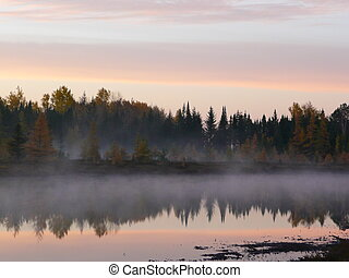 Reflections of sunrise - The reflections are shown well in...