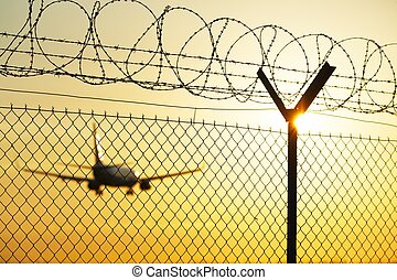 Airport at the sunset - security system