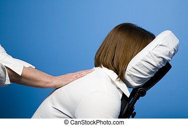 Chair massage - A woman getting a chair massage