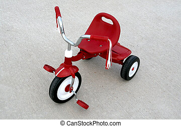 Red Tricycle - an empty red tricycle on a cement background