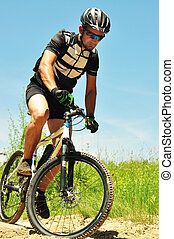 Offroad bicyclist - Cyclist on the Riding Bicycle Walk in...