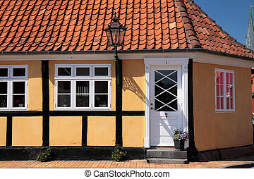 Yellow half-timbered house in Roenne on Bornholm