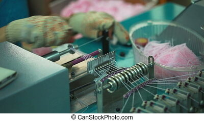 Knitter working for semi-automatic machine, close-up