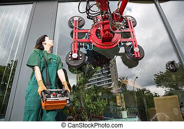 Glazier operating glass installation crane - Glaziers...