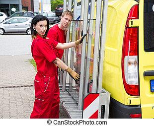 Glaziers with glass transportation truck - Glaziers loading...