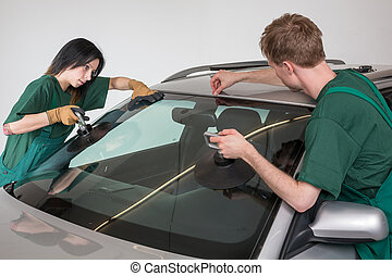 Glazier replacing windshield - Glazier removing windshield...