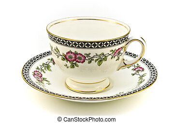 Floral patterned tea cup with saucer on a white background