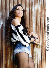 Attractive woman with denim shorts in urban backgroung -...
