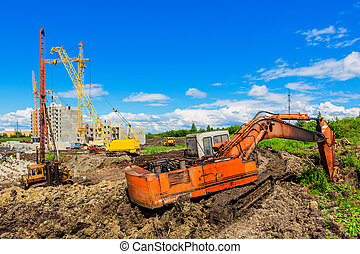 Construction site - Cranes and other machineries on the...