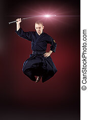 jump kendo - Handsome young man practicing kendo Over dark...