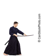 sword kendo - Handsome young man practicing kendo Isolated...