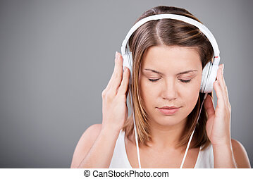 Listening music - Eyes closed female listening music through...