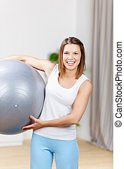 Fitness ball - Happy fit woman exercising with fitness ball