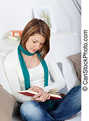Woman sitting reading on the sofa