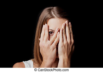 Anxiety - a conceptual image of a woman covering her face...