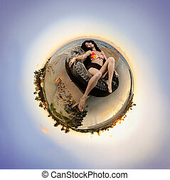Sunset beach microworld - Portrait of young woman relaxing...