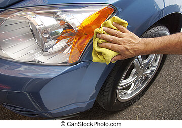Car maintenance - Hand polishing car fender with yellow...
