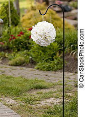 White orb flower ball hanging for a shepards hook