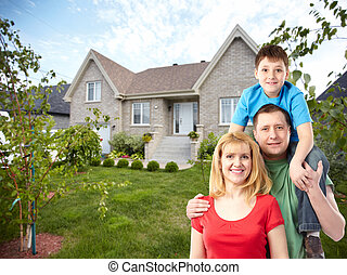 Happy family near new house Real estate