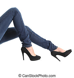 Woman legs with blue jeans and black platform heels - Close...
