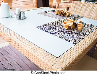Oriental style dining table with traditional napkins