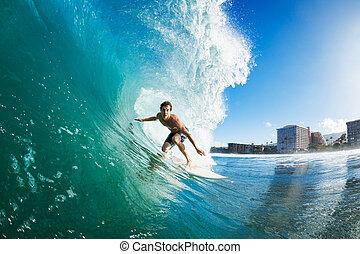 Surfer on Blue Ocean Wave Getting Barreled