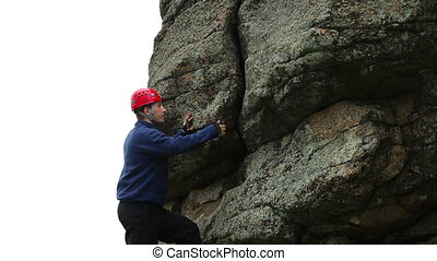 Climber - Man climbing up a steep rock.