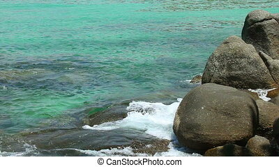 Rocky shore - Waves crushing against rocky shore.